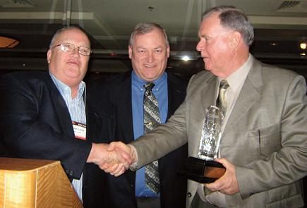 Rod Anderson (right) receiving The William Elton Outstanding Shareholder Award