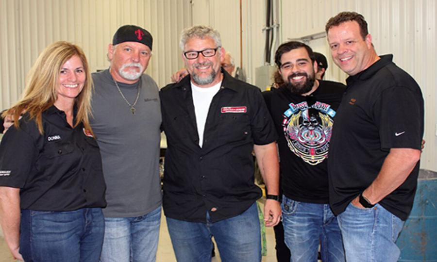 A few of the people at the demonstration held at Wallace's Conley Collision. From left: Donna Rioux, Manager of Peterborough Paint & Body Supply, House of Kolor's Market Manager Ron Fleenor, Darrin Heise and Dave Pereira of PBE Distributors and Chuck Rollins of Valspar. (Photo: Collision Repair magazine)
